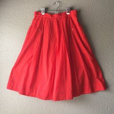 """Anthropologie Odille poppy red skirt Anthropologie Odille skirt. Size 6. Poppy red skirt. 100% cotton skirt with full cotton liner. Lightweight vibrant fabric. Full skirt with pleats at waist and adorable outer pockets accented by gold hardware. Exposed gold zipper closure in back. In excellent condition. Length 24"""", waist 13.75"""" across lying flat, hips free. Anthropologie Skirts"""