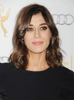 Lizzy Caplan attends Television Academy Performers Nominee Reception For The 66th Emmy Awards. Makeup by Jamie Greenberg. Styled by Ilaria Urbinati.