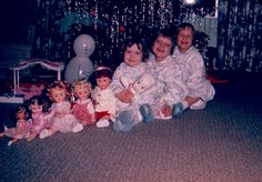 1956 Christmas Morning with the Dolls...Dad always got me and Phyllis a doll every year...I even remember the year Mom found Play-dough....we each got 1 can.....there were 4 of us...and I remember how extravegant Dad thought it was....58 years later ....I am still buying it for Zachary.....Love the smell....