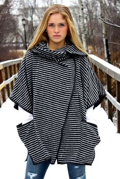 LOVE LOVE LOVE!!! A face-framing, envelope collar tops this superb quality poncho. So stylish, yet classic in design, this is a substantial piece that should be added to every woman's closet!