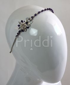 Cute side tiara with pretty purple crystals.