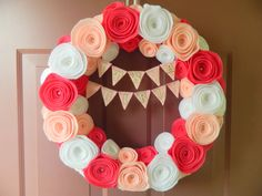 Baby Wreath - Nursery Wreath - It's A Girl Pendant Bunting Felt Flower Wreath in Pink and White with Pearls. $43.00, via Etsy. -- adorable. just with an initial or name, instead of the flags.
