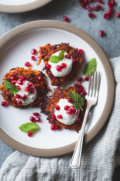Crispy sweet potato cakes get a kick from spicy harissa, chickpea flour, cumin-mint yoghurt sauce, and pomegranate.