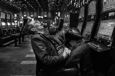 Sleeping in front of machines at a casino in Bethlehem, Pa. Many riders of a bus between the casino and Flushing, Queens, take the trips not to gamble, but to sell vouchers and coupons.  For dozens of Asian immigrants in Flushing, Queens, the back-and-forth bus trips they take to a casino in Pennsylvania aren't limbo — they're how they get by.