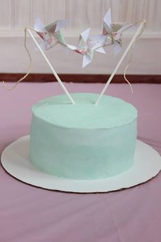 Ellie's 1st cake!  Baby girl, shabby chic birthday cake.    Pinwheel cake topper.