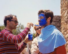 JLG painting Belmondo's face in Pierrot le Fou.