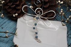 Love dragonflies? This handcrafted dragonfly ornament is simply beautiful with several wrapped pearls to give some shimmer and color. These are great as ornaments or hang in a window or in your car to enjoy all year.  Choose your wire color and pearl color.  Your ornament will be perfectly packaged in a white gift box ready to give to someone special.  MORE ORNAMENTS https://www.etsy.com/shop/wirewrap?ref=hdr_shop_menu&section_id=19921770