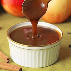 Autumn-Spiced Apple Cider Caramel Sauce - Shut the front door!  And it's easy to make too!  You could put it on pound cake, ice cream, pancakes...  It's a great Christmas gift too!