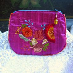 Handmade pouch from magenta floral embroidered silk fabric from India.