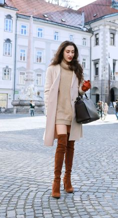 Fashion Blogger Veronika Lipar of Brunette from Wall dressed in double breasted coat, cable knit turtleneck camel sweater dress and Stuart Weitzman over the knee boots, brown Michael Kors Selma bag, leather gloves