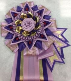 View our collection of ribbons and rosettes available in accents including floral, patterned, glittery golds, silvers and more. Ribbon Rosettes, Ribbons, Centaur, Photo Galleries, Spirit, Dog, Gallery, Floral, Pattern