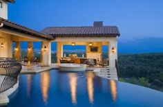 Infinity edge pool overlooking the Texas Hill Country with an amazing outdoor patio? Yes, please. by francisca