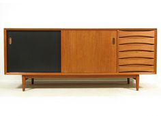 Sleek Danish Teak Sideboard by Arne Vodder for Sibast | From a unique collection of antique and modern sideboards at https://www.1stdibs.com/furniture/storage-case-pieces/sideboards/