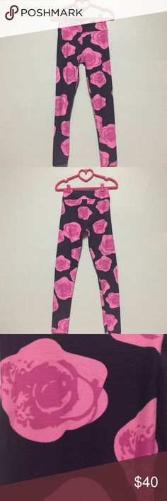 OS NWOT Disney roses leggings OS Disney rose/floral leggings. Never worn or tried on. Dark navy background with pink roses. Made in Vietnam. (Just trying to recoup some cost with posh fees) Offers welcome! LuLaRoe Pants Leggings