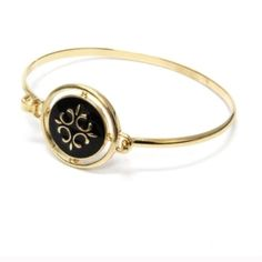 Black and gold bangle bracelet. Black and gold bangle Fun and perfect to dress up an outfit! Mix with other bangles or wear solo! Jewelry Bracelets