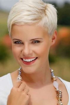 Short Straight Hairstyle with Blond Highlights Very-Short-Pixie-Cut