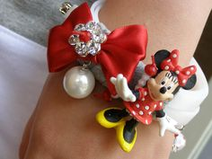 Handmade bracelet with cartoon, glass pearl, a big red knot with metallic daisy with swarovski rhinestone and glass beads