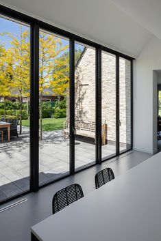 Completed in 2018 in Beek en Donk, The Netherlands. One house, five different volumes. House Kerkstraat is situated on a generous plot near to a main entrance of the village. The all new house replaces. Bungalow Extensions, House Extensions, Sliding Window Design, Modern Patio Doors, Mobile Home Bathrooms, House Windows, Home Additions, Architecture, Building A House