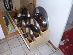 Tiered pan lid storage pull-out tray. Looks like a job for my man. Kitchen Organization, Kitchen Storage, Storage Organization, Storage Ideas, Organizing, Kitchen Updates, Updated Kitchen, Kitchen Ideas, Kitchen Design