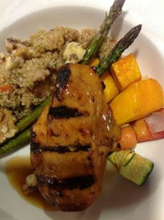Teriyaki Chicken w/ fresh squash, zucchini, onions, peppers and Asparagus served with a pear quinoa salad