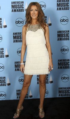 Celine Dion Photos Photos - Singer Celine Dion  poses in the press room at the 2007 American Music Awards held at the Nokia Theatre L.A. LIVE on November 18, 2007 in Los Angeles, California. - 2007 American Music Awards - Press Room