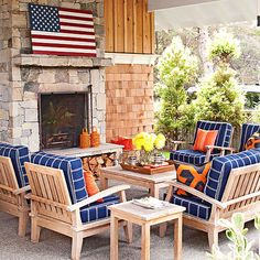 Navy and orange create a spunky color scheme for this pattern-filled patio. See the rest of this cottage home: http://www.bhg.com/decorating/decorating-style/cottage/cottage-for-entertaining/?socsrc=bhgpin040313orangebluepatio=9