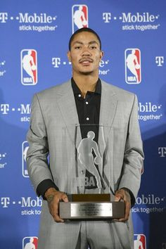 Chicago Bull's player Derrick Rose poses with his trophy after winning NBA Rookie of the Year