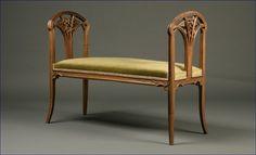 "1107: A Louis Majorelle walnut ""Clematis"" window bench"