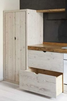 Italy-based German interior designer and furniture maker Katrin Arens uses discarded wood for cabinets.