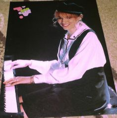 Debbie Gibson 80's Bop Magazine pin up on the piano and smiling at the camera