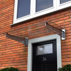door canopy with steel brackets and glass top: Type G