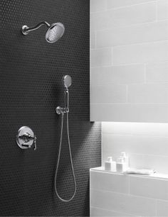 Black tile meets white marble with chrome Kohler Artifacts shower