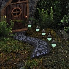 Saw these acorn lights on myfairygardens.com. Thought they'd be easy to make with acorns and glow in the dark paint. Going to give it a try.