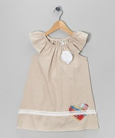 The perfect complement to any darling girl, this dress's classic silhouette and vintage detailing are completely charming. Soft cotton construction keeps the frock ultra-wearable, while sweet angel sleeves and an elastic neckline create a fluttery fit.100% cotton exclusive of decorationMachine wash; tumble dryMade in th...