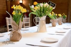 Daffodils and tulips make such a fresh looking display on the wedding tables. What a great choice of flowers for a Spring wedding.