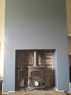 Stiffkey blue chimney breast (colours of this photo look a bit off. Dining Room Colour Schemes, Living Room Shelves, Chimney Decor, Dining Room Blue, Fake Brick Wall, Fireplace, Sitting Room Decor, Diner Decor, Wood Burning Stove