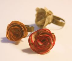 A red #rose, an orange one and one just the color of the #paper it's made of. So nice #rings