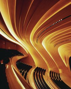 The backlit oak panels in the conference centers 1,000-seat auditorium bring warmth to the otherwise vividly white interior.