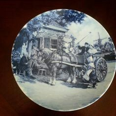 This Ter Steege Delft Blue Made in Holland Collector Plate.  It is a horse drawn carriage 1984  FARM SCENES HAND DECORATED IN HOLLAND