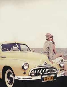 pale yellow car by the sea