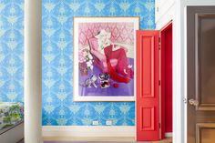 Make an Entrance. Blue damask wallpaper. NYC home - SoHo loft - of PR exec MT Carney. Interior Design: Michael Adams.