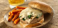 Make these irresistible turkey burgers for your next cookout and enjoy the savory flavors of sautéed garlicky mushrooms with spinach and melted Sargento® Ultra Thin Slices™ Swiss Cheese on top of every patty in between a lightly toasted bun.