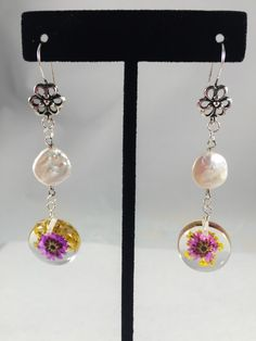 A personal favorite from my Etsy shop https://www.etsy.com/listing/267848362/freshwater-pearl-pressed-flowers-in