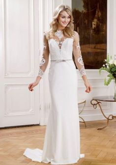 Sweetheart neckline with long mesh laced sleeves. Satin train complimented with small belt to emphasise waist.