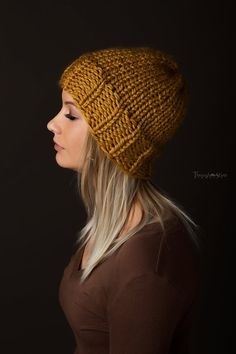 This handmade knit beanie is a lovely addition to any persons wardrobe. It is thick and warm! Perfect for chilly fall nights, or the cold winter months! Stay warm and stylish with this handmade beanie. One size fits most. Length : About 10 inch Width : stretchy Contact me for any specific questions. ie. Color variations, Sizes, custom orders, etc.  **These items are made in a smoke-free home. CARE: Hand wash in cold water and lay flat to dry. Colors may vary slightly. All items are made with…