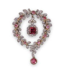 A FINE AND RARE FANCY RED DIAMOND, COLOURED DIAMOND AND DIAMOND BROOCH Set with a rectangular-cut fancy red diamond weighing 0.73 carat, in an old-cut diamond surround, suspended from a diamond-set foliate garland, enhanced with pink diamond collets, 4.3 cm. high