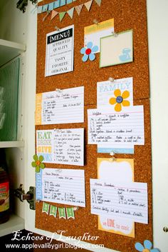 corkboard on inside of cupboard door for holding recipes/ coupons/etc.