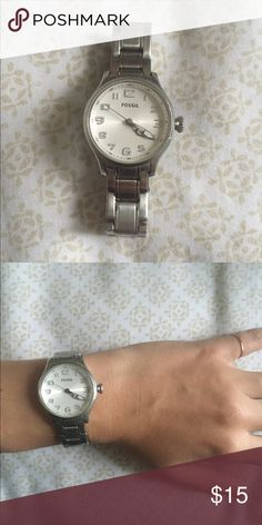 fossil watch - batteries out but still works! silver fossil watch! would say it's for smaller wrists - two links were taken out originally. batteries are dead but cheap, also they replace your battery in store if you go ask. Fossil Jewelry
