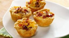 Mini Bacon-Cheese Cups - a bite-sized quiche made easy with refrigerated pie crust, filled with cream cheese, eggs, green onions, Swiss cheese, and bacon.