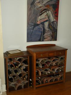 Really neat wine rack made from concrete roof tiles and old chests of drawers by Vine Dawgs.